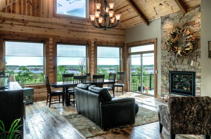 Greatroom with awesome lake views & beautiful barn wood floor.