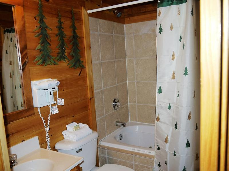 The main bathroom has a jetted tub and shower.  Hair dryers are provided.