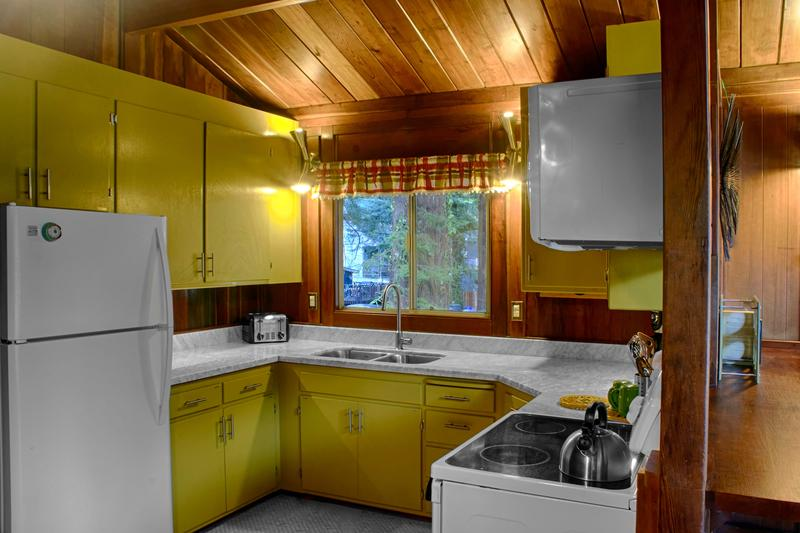 The kitchen is fully equipped and has new marble counters and floors. The marble floor has radiant heat.