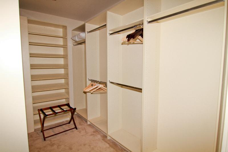 Marylin Suite walk in closet with refrigerator and safe.