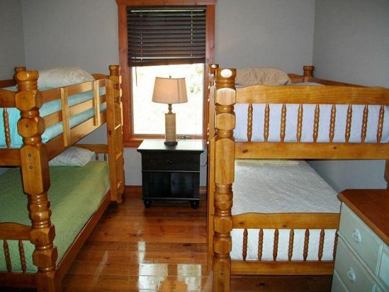 Main level bedroom, sleeps 4, two sets of bunkbeds.