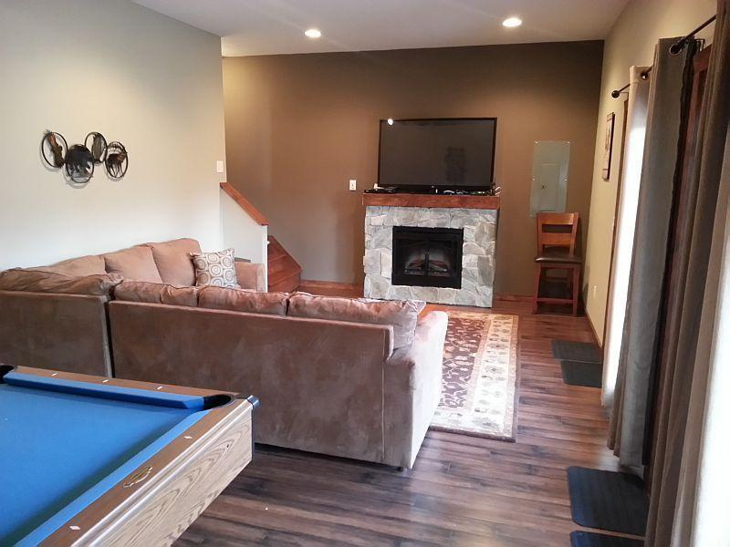Newly finished basement includes electric fireplace.