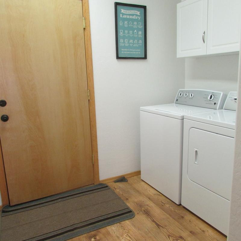Laundry room with full size washer & dryer.