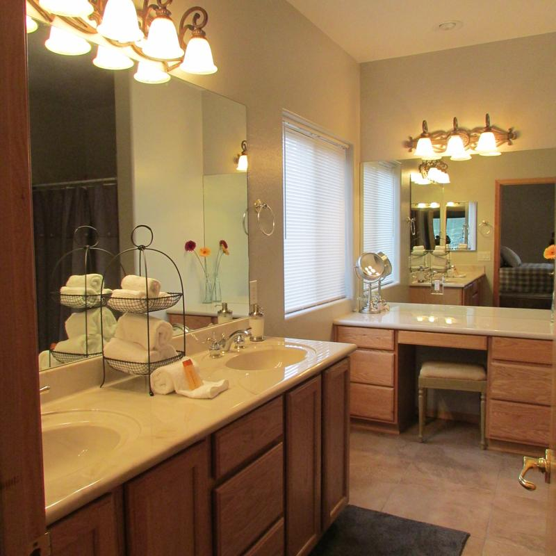 Master bathroom features double sinks, makeup vanity and shower.