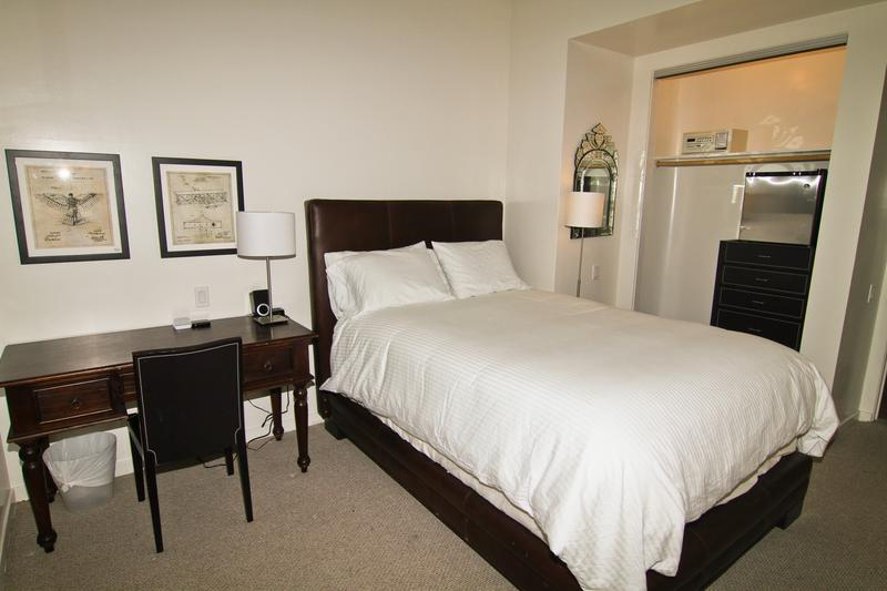 "The Wright Bros. Suite: Queen bed, full bath, 45"" TV, work desk, safe, fridge."